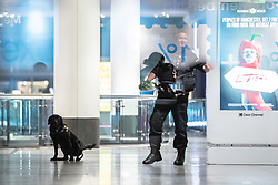 © Licensed to London News Pictures. 18/10/2019. Manchester, UK. A police search dog does a poo on the floor of the Arndale Centre as armed police and paramedics respond and the Arndale Centre in Manchester City Centre is evacuated after reports of a man armed with a knife in the shopping centre . Photo credit: Joel Goodman/LNP