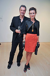 TV presenter GAVIN ESLER and musician ANNA PHOEBE at an exhibition of photographic portraits by Bryan Adams entitled 'Hear The World' at The Saatchi Gallery, King's Road, London on 21st July 2009.