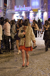 "© under license to London News Pictures. 18/12/2010 as snow blizzards hit Manchester revellers continue their ""Mad Friday"" night out. The temperature dropped below zero, but that didn't stop many"