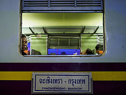 May 31, 2017 - Chachoengsao, Chachoengsao, Thailand - A passenger looks out his window on the 5.45AM train, the first train of the day, at the train station in Chachoengsao, a provincial town about 50 miles and about an hour by train from Bangkok. The train from Chachoengsao to Bangkok takes a little over an hour but traffic on the roads is so bad that the same drive can take two to three hours. Thousands of Thais live outside of Bangkok and commute into the city for work on trains, busses and boats. (Credit Image: © Jack Kurtz via ZUMA Wire)