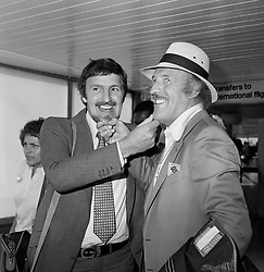 File photo dated 28/06/79 of Jimmy Hill, former managing director of Coventry City FC and Sir Bruce Forsyth at Heathrow Airport as they leave for Tobago to take part in a charity golf tournament, as the veteran entertainer has died aged 89.