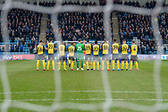 The teams honour Gordon Banks with a minutes applause  before the EFL Sky Bet League 1 match between Gillingham and Scunthorpe United at the MEMS Priestfield Stadium, Gillingham, England on 16 February 2019.