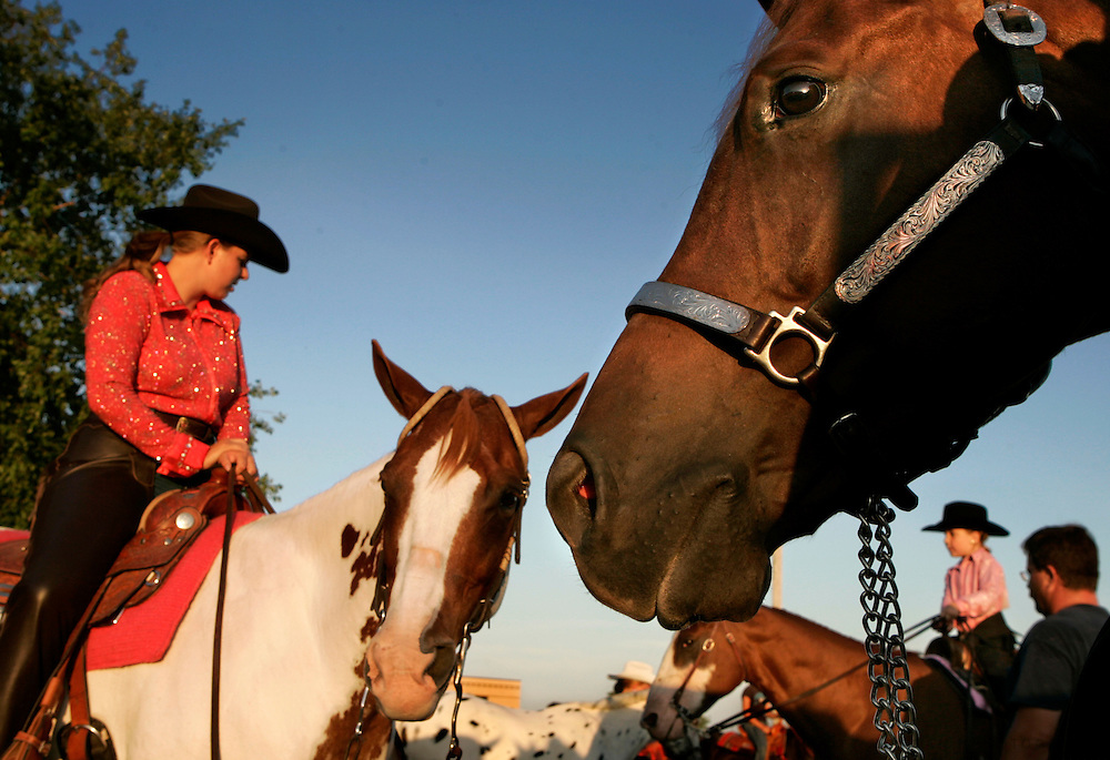 A Legend With Time, a 6-year-old quarter horse, right, looks toward the ring as Greta Cummings of Mount Union, left, looks at Rachel Kuckes, 5, of Mount Pleasant, Sunday, July 30, 2006, before taking part in the horse show at the Des Moines County Fairgrounds in West Burlington. Scott Morgan   The Hawk Eye