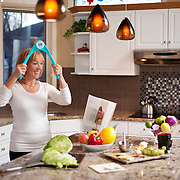 Advertising photography for UB Toner. <br /> Photo of a 50 Year old woman training with the UB Toner Fitness Trainer<br /> Art Direction: Brett Gilmour<br /> Styling: Judith Aldama<br /> Photography: Brett Gilmour