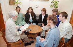 Group of people sitting around table having informal meeting,