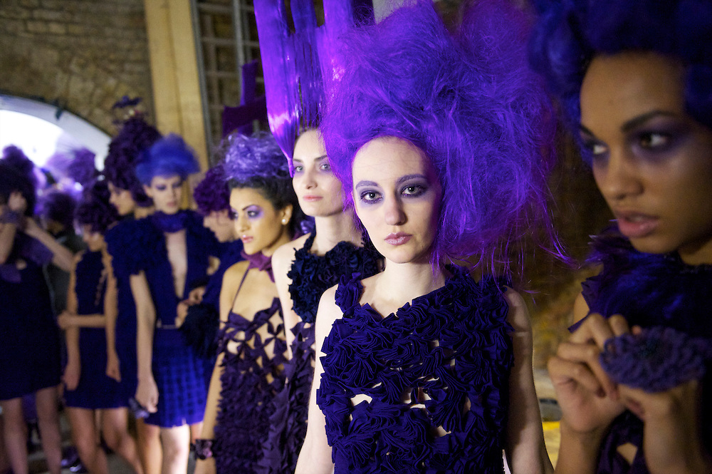 Models line up backstage before the Pierre Garroudi autumn 2011 collection at his gallery in London on 19 February 2011.