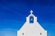 White greek chapel on the blue sky