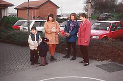 Parents dropping children off at junior school,