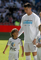 Zaid Abdul, Syrian refugee boy on the court at Santiago Bernabeu Stadium with Cristiano Ronaldo before Real Madrid vs Granada, La Liga match. September 19,2015. (ALTERPHOTOS/Acero)