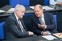 21 MAR 2019, BERLIN/GERMANY:<br /> Horst Seehofer (L), CSU, Bundesinnenminister, und Olaf Scholz (R), SPD, Bundesfinanzminister, im Gespraech, vor Beginn der Bundestagsdebatte zur Regierungserklaerung der Bundeskanzlerin zum Europaeischen Rat, Plenum, Deutscher Bundestag<br /> IMAGE: 20190321-01-080<br /> KEYWORDS: Gespräch