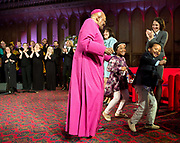 Former archbishop Desmond Tutu with his grandson Khalil Morrison, 6 with his granddaughter Onalina Burris, 7 at a ceremony receiving the 2013 Templeton Prize at the Guildhall in London, UK. South African anti-apartheid campaigner Desmond Tutu won the 2013 Templeton Prize worth $1.7 million for helping inspire people around the world by promoting forgiveness and justice.