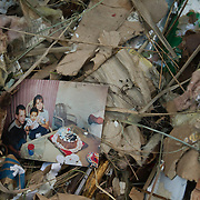 A family photograph lies among wreckage in Union Beach, NJ after Superstorm Sandy. The storm-surge from Superstorm Sandy destroyed several oceanfront blocks of Union Beach, leveling homes or lifting them off their foundations, breaking them apart and moving them.