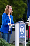 12 SEPTEMBER 2020 - DES MOINES, IOWA: Representative CINDY AXNE, the Democratic freshman US Congressperson up for reelection speaks at the Polk County Democrats Steak Fry in Waterworks Park in Des Moines. The Steak Fry is the largest fundraiser of the year for Polk County Democrats. This year nearly 1,000 people attended. The Steak Fry observed public health guidelines. Normally the Steak Fry is a picnic but this year people stayed in their cars while meals were brought to them and they wore masks when they were outside of the cars. Most of the speakers appeared via online speeches.    PHOTO BY JACK KURTZ