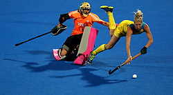 Australia's Jodie Kenny is tackled by Argentina's Belen Suscci during the penalty shootout