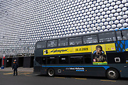 Sign advertising the computer game Cyberpunk 2077 on the side of a bus outside the Selfridges building on 18th January 2020 in Birmingham, United Kingdom. Cyberpunk 2077 is a 2020 action role-playing video game developed and published by CD Projekt. Players assume the first-person perspective of a customisable mercenary known as V, who can acquire skills in hacking and machinery with options for melee and ranged combat. Following its release it was widely criticized for bugs, particularly in the console versions which also suffered from performance issues; Sony removed it from the PlayStation Store on 17 December 2020.