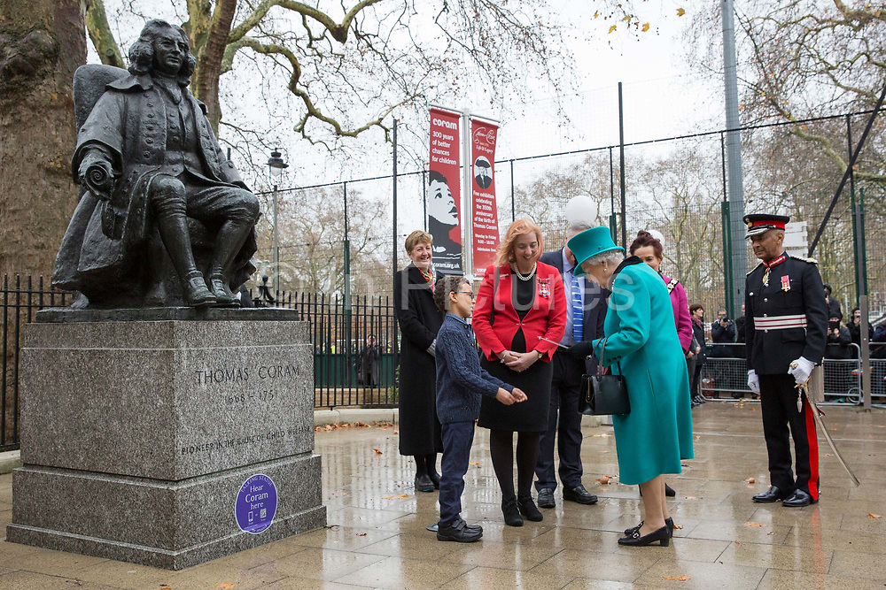 Queen Elizabeth II with Dr Carol Homden CBE Group Chief Executive of Coram during a visit to childrens charity Coram to open the Queen Elizabeth II centre on 5th December 2018 in London, England. Coram is the UK's oldest childrens charity and was founded by Thomas Coram.