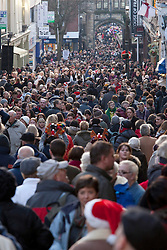 © Licensed to London News Pictures.09/12/2012. Lincoln,UK. On one of the busiest shopping weekends before Christmas, shoppers pack the streets of Lincoln. Pictured, Shoppers pack this view taken down the High Street in Lincoln. Photo credit : Dave Warren/LNP