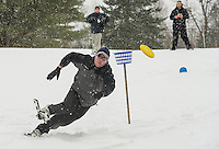 Ryan McGarghan makes a great effort to catch Jason Baldini's toss during Tavern 27's Showshoe Disc Golf Tourney Saturday afternoon at the Mystic Meadows course.  (Karen Bobotas/for the Laconia Daily Sun)