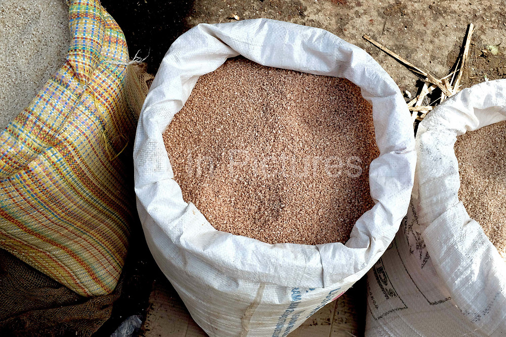 Locally produced red rice, which has a slightly nutty flavour, for sale at the Sunday market in Paro, Western Bhutan. Paro's weekly market is a small traditional market and the place to purchase Bhutan's unique local products.