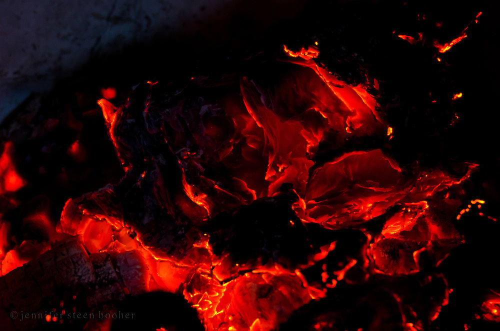 Close-up of red-hot coals in the fire.