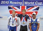 Bled, SLOVENIA,  Centre GBR LM1X Gold Medalist, Zac PURCHASE, men's lightweight single sculls winner, left Silver, FRA LM1X, Maxime GOISSET, Right, BRA LM1X, Ailson SILVA, on the second day of the FISA World Cup, Bled. Held on Lake Bled.  Saturday  29/05/2010  [Mandatory Credit Peter Spurrier/ Intersport Images]