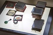Magic lantern slides, brush, magnifying loop on Vis-Tra-Lite Lightbox, old photographs