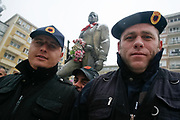 The 1998-99 Kosovo war veterans draped in the flags and military uniforms of the now-disbanded Kosovo Liberation Army participates in a protest in support of former rebels charged by a European Union prosecutor of war crimes during the 1998-99 Kosovo war in the capital Pristina on Friday, Dec 30, 2011. (Photo/ Vudi Xhymshiti)