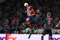 May 3, 2018 - Madrid, Spain - DIEGO GODIN of Atletico de Madrid heads the ball under pressure from ALEXANDRE LACAZETTE of Arsenal FC during the UEFA Europa League, semi final, 2nd leg football match between Atletico de Madrid and Arsenal FC on May 3, 2018 at Metropolitano stadium in Madrid, Spain (Credit Image: © Manuel Blondeau via ZUMA Wire)