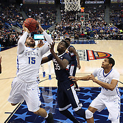Marquel Curtis, (left), drives to the basket past Amida Brimah, UConn, during the UConn Huskies Vs Tulsa Semi Final game at the American Athletic Conference Men's College Basketball Championships 2015 at the XL Center, Hartford, Connecticut, USA. 14th March 2015. Photo Tim Clayton