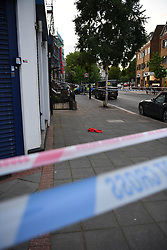 © Licensed to London News Pictures. 01/07/2019. London, UK. Police tape surrounding crime scene. A man is fighting for his life in hospital having sustained puncture injuries to the neck. The victim in his 30s is understood to be in a critical condition following the assault. Police responded to a call at 5.12pm reporting a fight and attended an address in Argyle Road, West Ealing. Another man also in his 30s has been arrested.Photo credit: Guilhem Baker/LNP