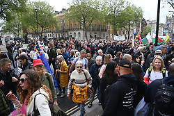 © Licensed to London News Pictures. 15/05/2021. London, UK. Anti-vaccination and anti-lockdown protesters take part in an organised demonstration in central London. It has been over a year since the UK went into lockdown due to the rise in Covid-19 cases. Photo credit: Ray Tang/LNP