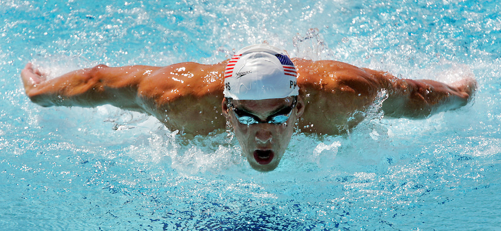 U.S. swimmer Michael Phelps finished first in his preliminary heat in the men's 200m individual medley Wednesday morning at the Olympic Aquatic Centre in Athens, Greece. Phelps qualified with a 2:00.01 time and will race again in tonight's semifinal.