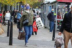 © Licensed to London News Pictures. 01/11/2020. London, UK. A shopper carrying a pack of toilet rolls in north London, as panic buying continues. This is following the announcement of the second lockdown in England from Thursday 5 November until Wednesday 2 December,  as coronavirus cases are increasing. Minister for the Cabinet Office, Michael Gove, has said that the four-week shut-down could be extended into December if needed. Photo credit: Dinendra Haria/LNP