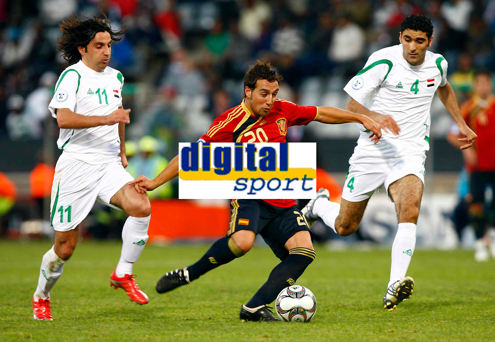Santi Cazorla of Spain and Villarreal Fareed Majeed of Iraq Hawar Mulla Mohammed of Iraq  FIFA Confederations Cup South Africa 2009 <br /> Spain   v Iraq Group B at Free State  Stadium Mangaung / Bloemfontein South Africa<br /> 17/06/2009 Credit Colorsport / Kieran Galvin