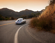 Image of the silver 1951 Porsche Gmund 356 SL 063 coupe which won its class at the 1951 Le Mans in France, on Mulholland Drive in Hollywood, California, America west coast. The Gmund was restored to its original look as it had finished Le Mans by Rod Emory and his team at Emory Motorsports in North Hollywood, California by Randy Wells