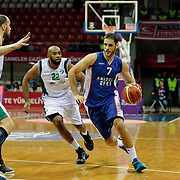 Anadolu Efes's  Stratos Perperoglou (R) and Darussafaka Dogus's Jamon Alfred Lucas (C) during their Royal Hali Gaziantep Turkey Cup Semifinals match Anadolu Efes between Darussafaka Dogus at Karatas Sahinbey Arena in Gaziantep Turkey on Friday 20 February 2015. Photo by Aykut AKICI/TURKPIX