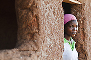 Abdulai Sadia stands in the doorway of the school where she used to teach children in the community of Kunayili, near Gushegu, Northern Ghana, on Wednesday November 2, 2011. Part of the roof collapsed a few months back, and she now teaches in another building lent by a community member.