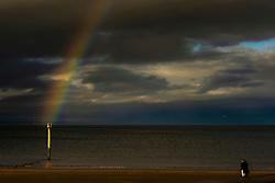 Dark clouds were brightened by a rainbow on Portobello Beach this afternoon.<br /> © Jon Davey/ EEm