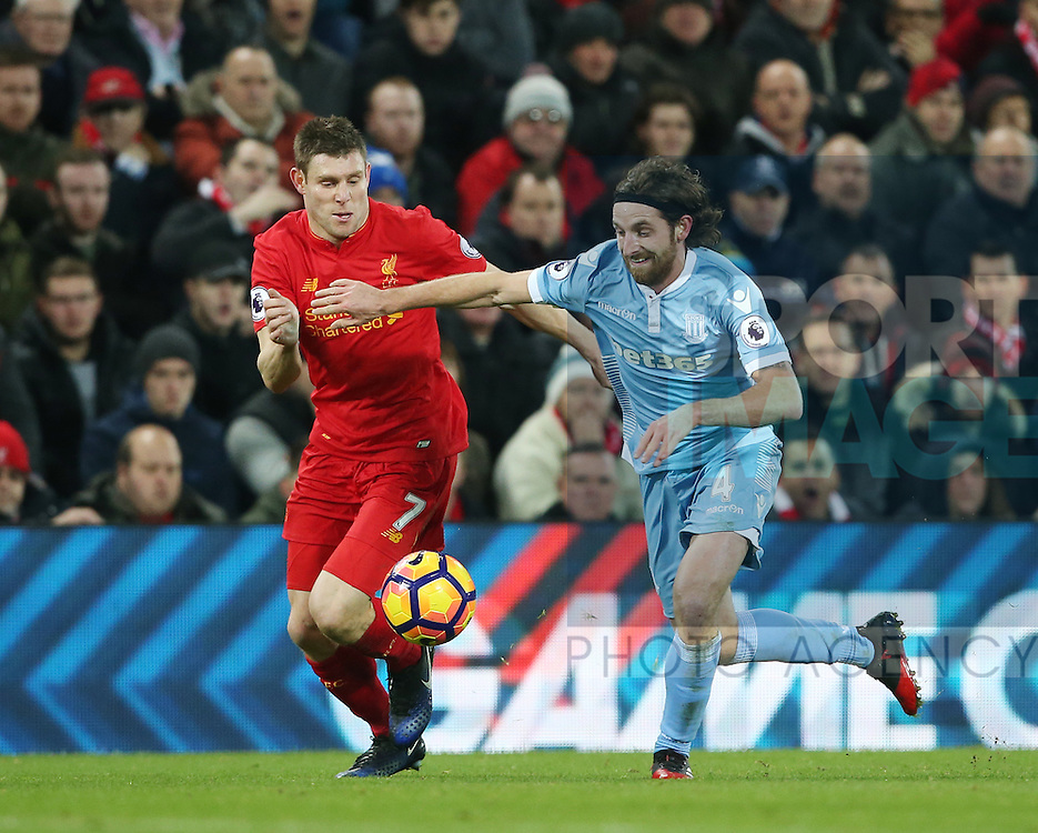Liverpool's James Milner tussles with Stoke's Joe Allen during the Premier League match at Anfield Stadium, Liverpool. Picture date December 27th, 2016 Pic David Klein/Sportimage