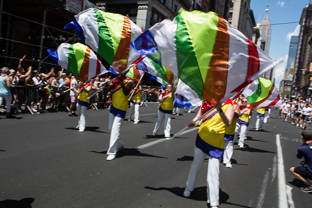 New York, NY - 30 June 2019. The New York City Heritage of Pride March filled Fifth Avenue for hours with participants from the LGBTQ community and it's supporters. Marchers with brightly colored flags perform a routine.