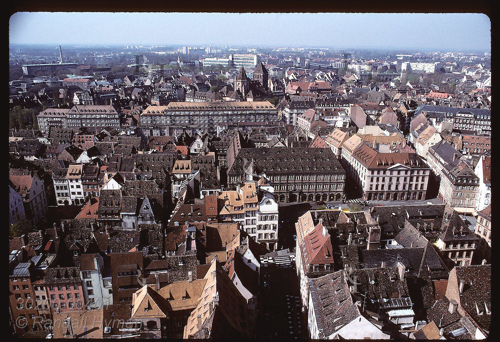 View atop the Cathedral of the horizon & jumble of tile roofs on buildings in central Strasbourg. France
