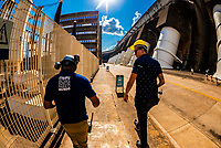 Workers at the Itaipu Hydroelectric Power Plant, on the border of Brazil and Paraguay.<br /> <br /> In terms of power output, Itaipú Dam is one of the world's largest hydroelectric projects. Its 20 massive turbine generators, located in the powerhouse at the base of the dam, are capable of generating 14,000 megawatts of electricity.