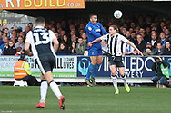 AFC Wimbledon defender Rod McDonald (26) winning header against Gillingham attacker Tom Eaves (9) during the EFL Sky Bet League 1 match between AFC Wimbledon and Gillingham at the Cherry Red Records Stadium, Kingston, England on 23 March 2019.