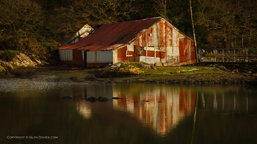 Late afternoon sunlight on a dilapidated old boathouse in Porthaethwy on the Isle of Anglesey.  This place has been patched & patched over the years and I'm surprised it's still standing at all.