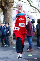 © Licensed to London News Pictures. 28/02/2017. London, UK. ITV News' ALASTAIR STEWART OBE races against MPs and Lords at the annual Rehab Parliamentary Pancake Race outside the Parliament on Shrove Tuesday, 28 February 2017. Photo credit: Tolga Akmen/LNP
