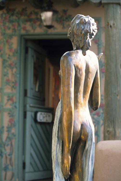 North America, United States, New Mexico, Santa Fe, statue in garden near art gallery