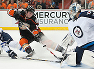 The Ducks' Matt Beleskey chases the puck into Jets' goaltender Ondrej Pavelec during the second period of Game 1 of the Western Conference Semifinals at Honda Center Thursday night.