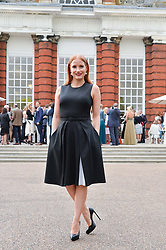 JESSICA CHASTAIN at The Ralph Lauren & Vogue Wimbledon Summer Cocktail Party at The Orangery, Kensington Palace, London on 22nd June 2015.  The event is to celebrate ten years of Ralph Lauren as official outfitter to the Championships, Wimbledon.