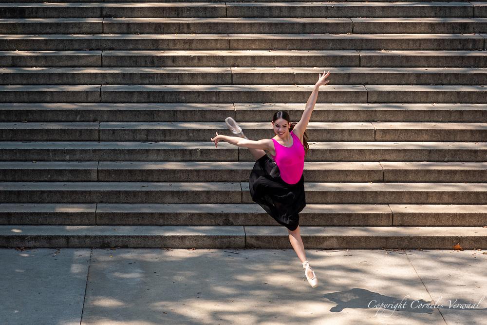 A moment of joy on the stairs at Bethesda Terrace in Central Park.
