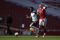 Football - 2020 /2021 Premier League - Arsenal v Fulham - Emirate Stadium<br /> <br /> Fulham's Josh Maja holds off the challenge from Arsenal's Granit Xhaka.<br /> <br /> COLORSPORT